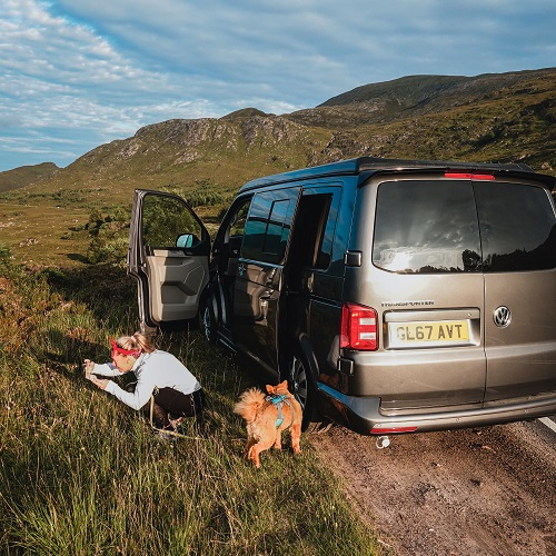 VW Transporter Campervan, mountains, girl with dog on an adventure - Where to go in your campervan