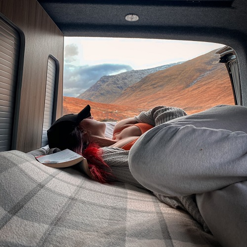 Relaxing in a campervan hired through Breakout Campers